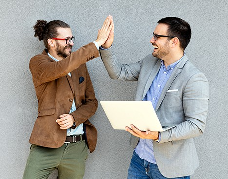two people high fiving eachother
